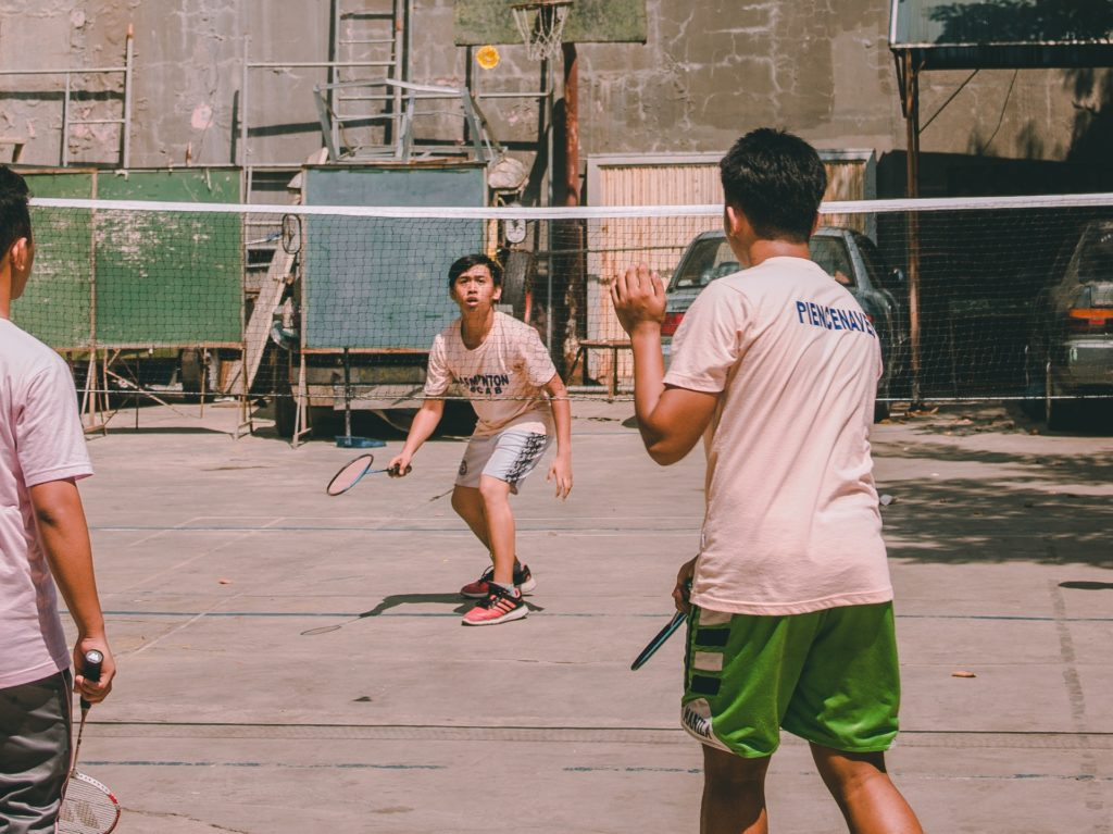 photo of boys playing badminton 3064150